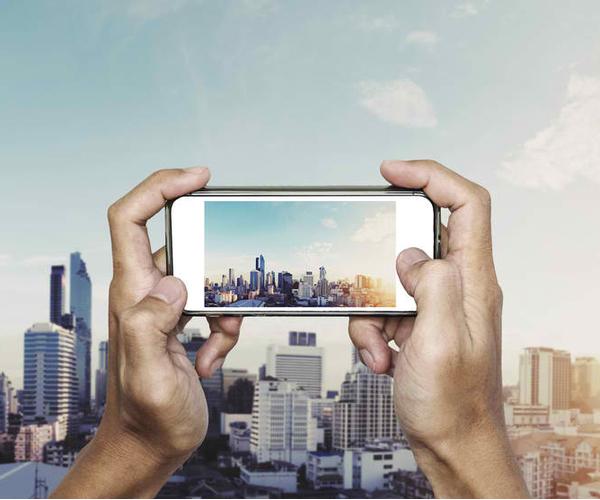 A man capturing a beautiful city.