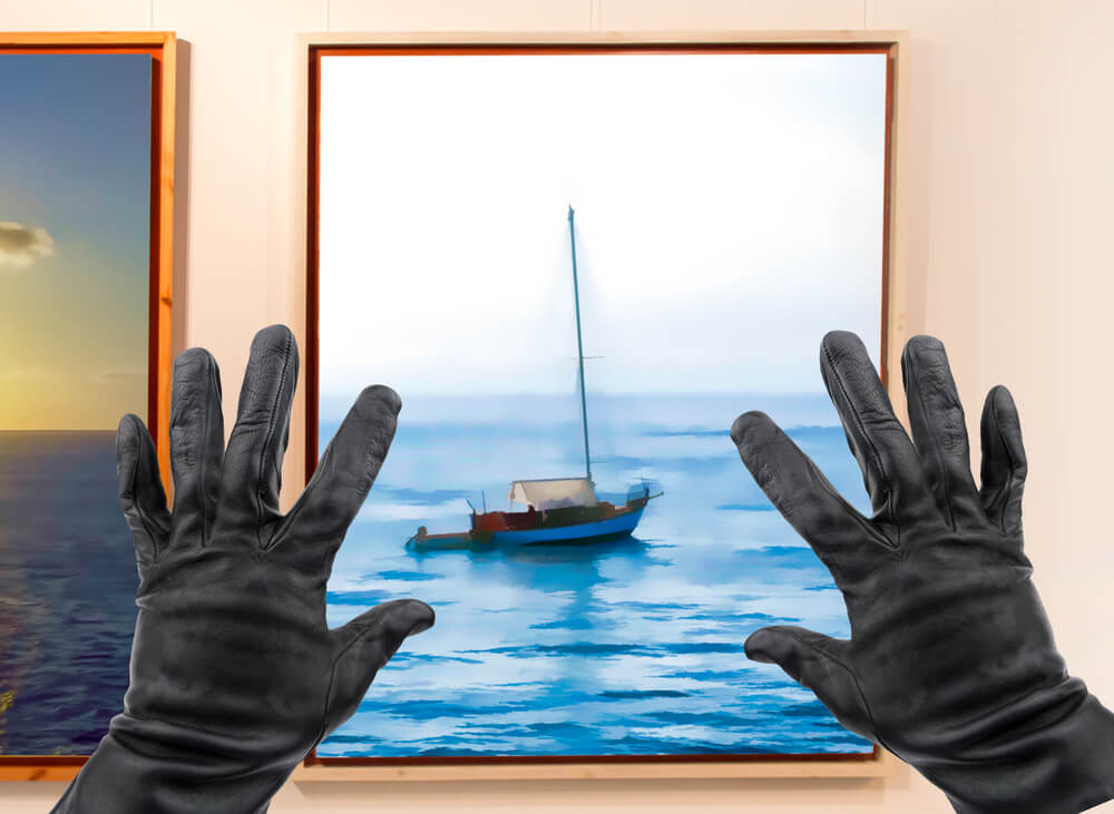 two hands wearing black gloves, adjusting the frame of a painting of a sailboat. - photograph artwork with iPhone