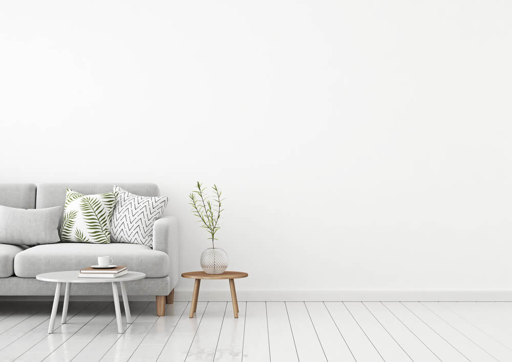 bright lit living room with one white sofa - photograph artwork with iPhone
