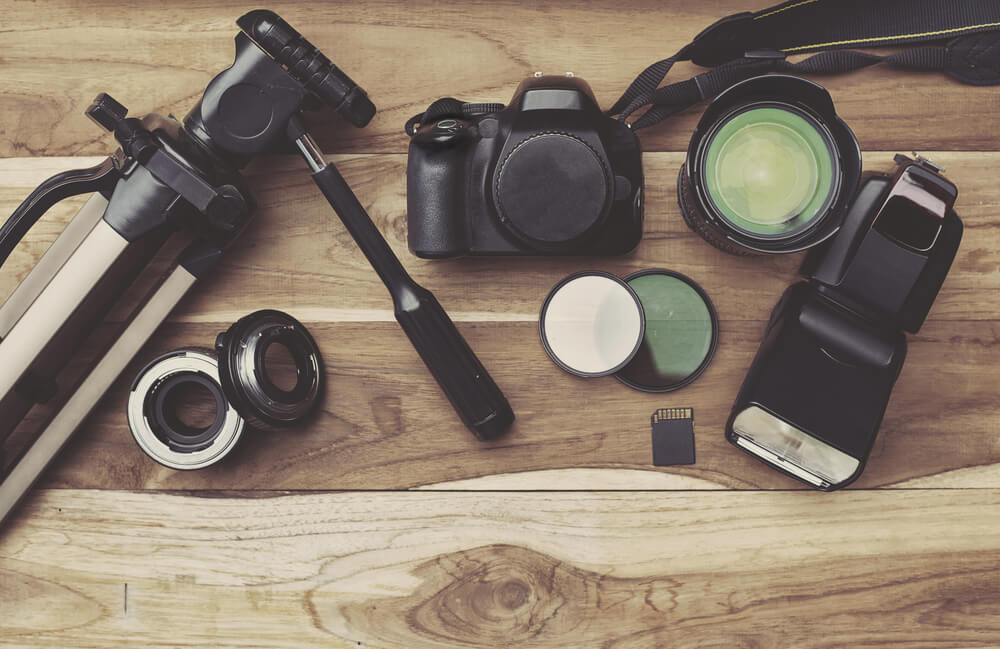 photography equipment on wooden table.