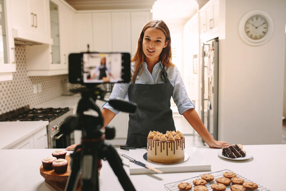 Chef filming herself making cake.