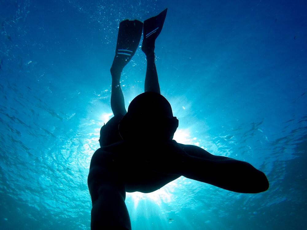 Dark underwater selfie of a diver