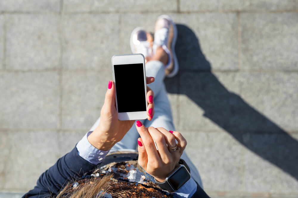 stylish girl holding a black screen iPhone. - freezing iPhone camera
