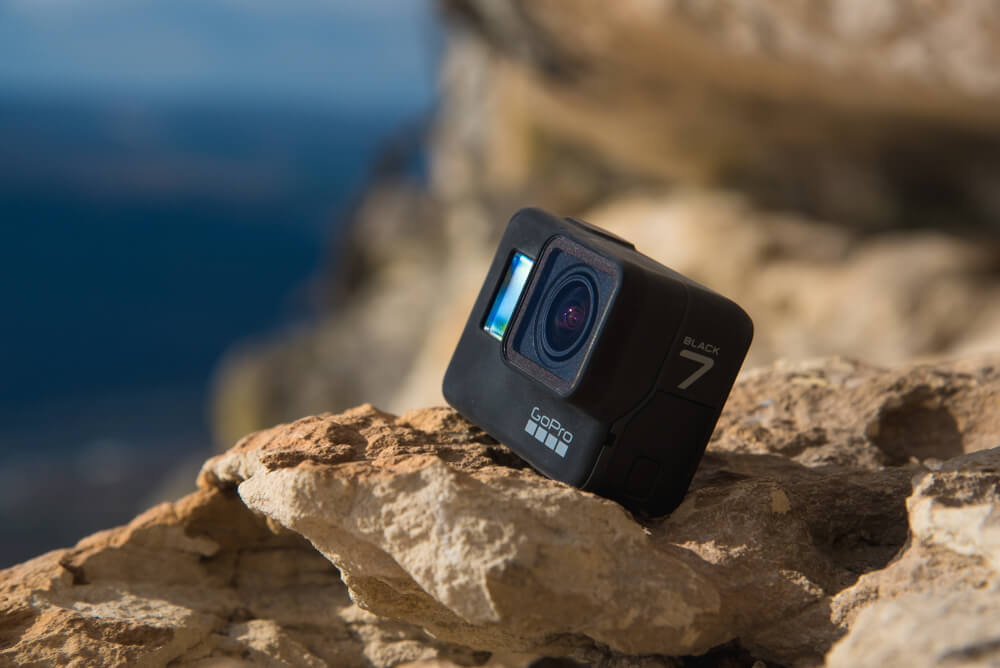 GoPro HERO 7 Black on brown rocks.