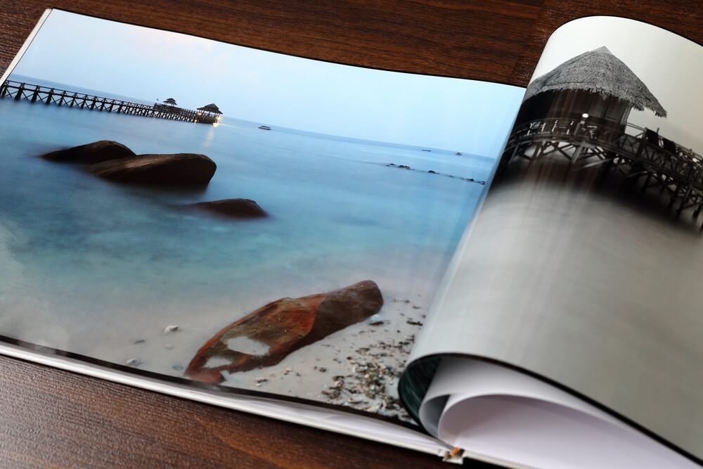 stunning spread of a beach on a photo book.
