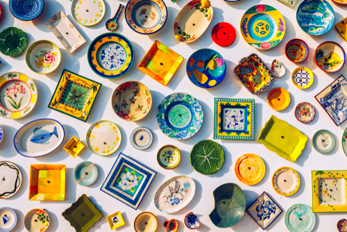Collection of colorful Portuguese ceramic pottery, local craft products from Portugal.