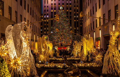 A christmas tree in front of Rockefeller center during christmas holiday