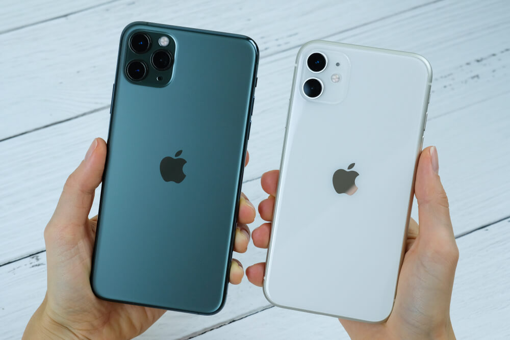 white iPhone 11 and space gray iPhone 11 Pro Max.