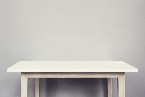 Empty top of natural stone table and grey wall background.