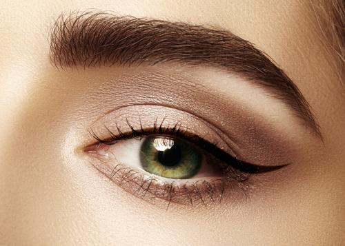 Beautiful macro shot of female eye with classic eyeliner makeup.