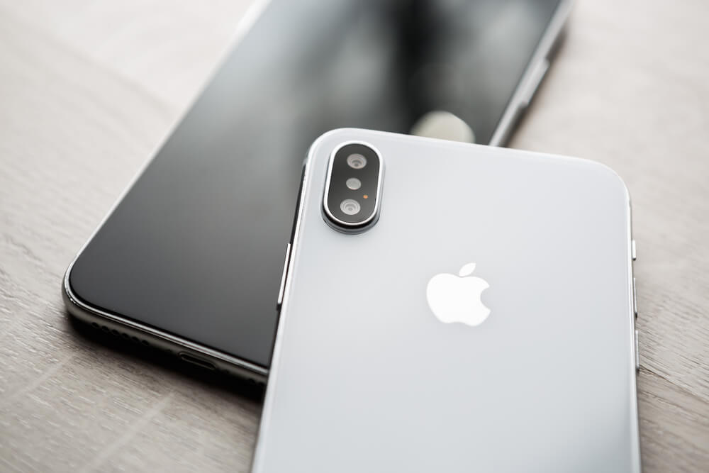 two iPhones, gray and black.