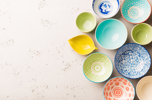 Collection of empty colorful (pastel) decorative ceramic bowls.