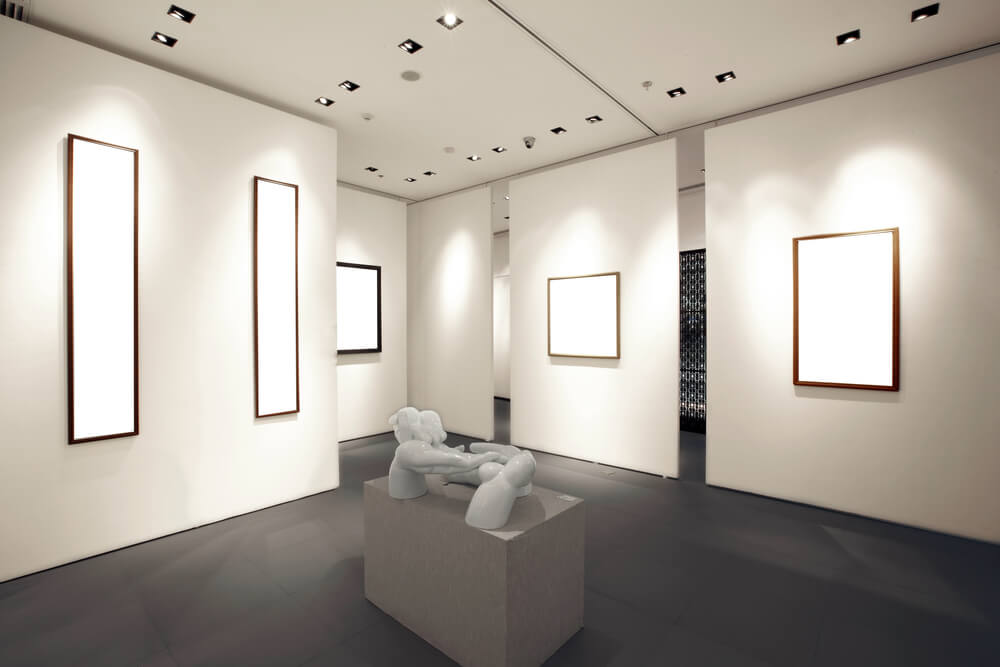 empty and moderately lit art gallery with white walls, blank canvases, and a statue on the middle. - photograph artwork with iPhone