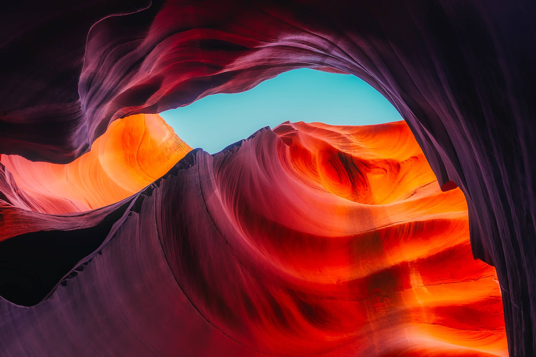 vibrant warm-colored canyon rocks and cerulean sky. - iPhone camera antelope canyon