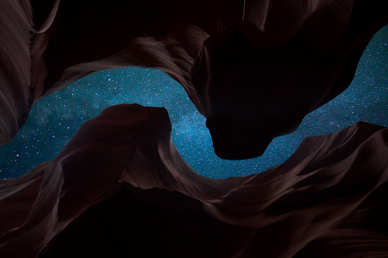 star-filled night sky between two rock formations, shot from a low angle inside the canyon - iPhone camera antelope canyon
