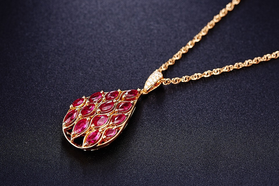 Necklace with ruby pendant in black background