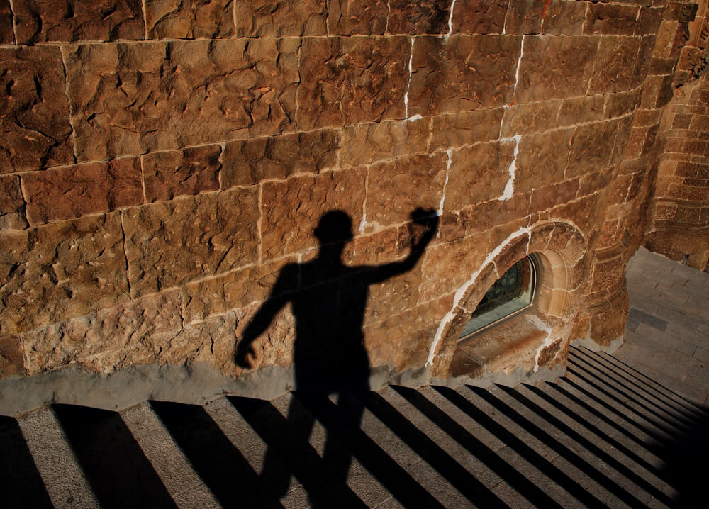 shadow selfie on stairs at old ruins.