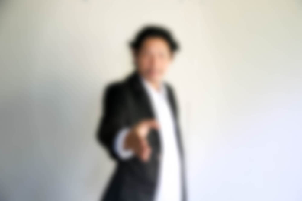blurry photo of a guy in corporate attire.  - passport photo iPhone