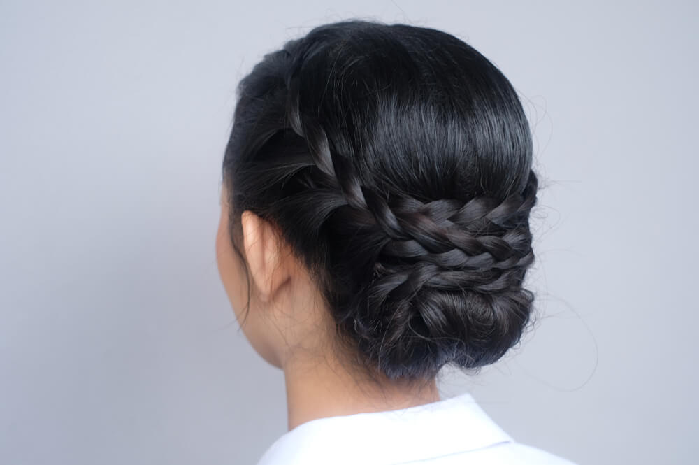 french braid of an Asian girl in rear view