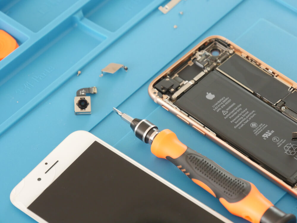 opened iPhone, exposed internal parts, and removed camera.