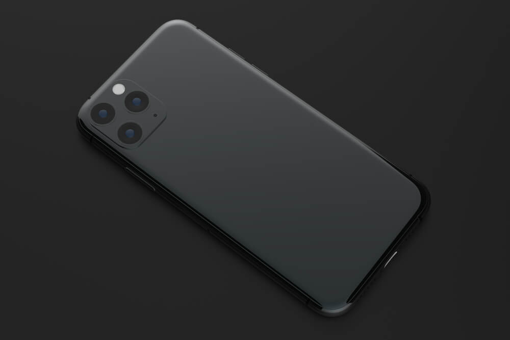black iPhone 11 Pro Max laid down on black ground. - iPhone camera filters