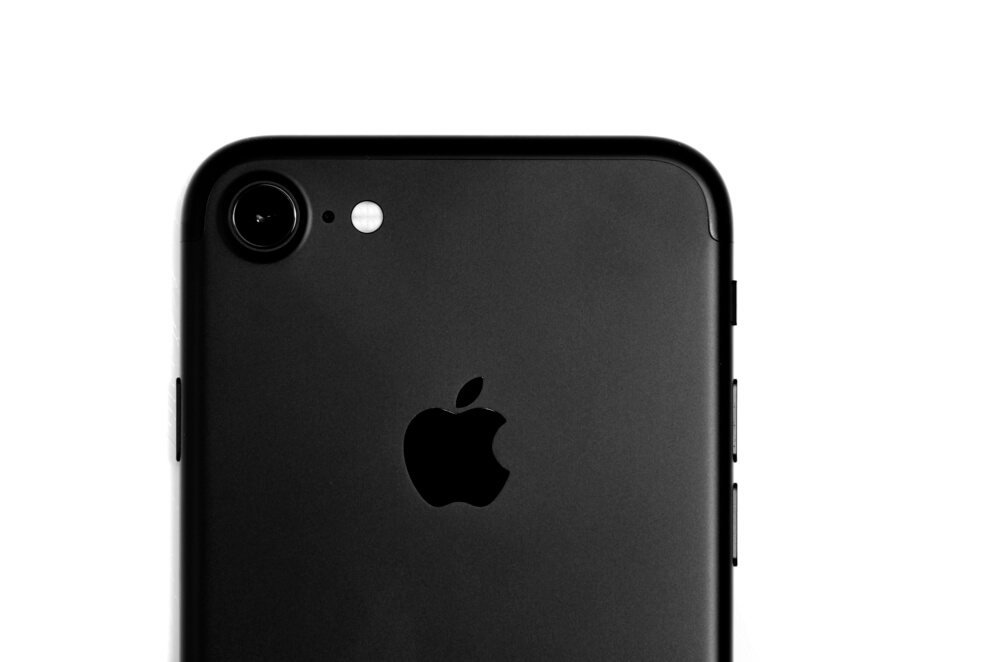 a black iPhone 7 on white background. - replace iPhone camera