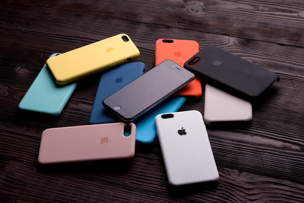 colorful gel iPhone cases on wooden table. - iPhone camera shaking