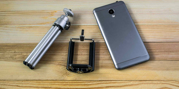 Mobile phone with tripod and clip for it