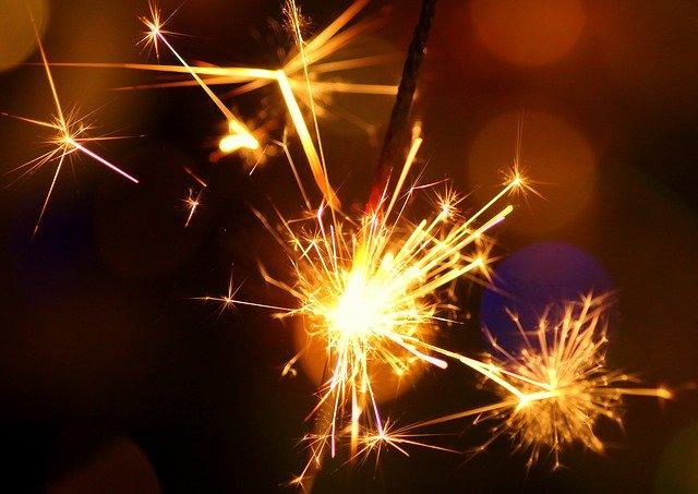 Sparkler sparks on a New Year's eve.
