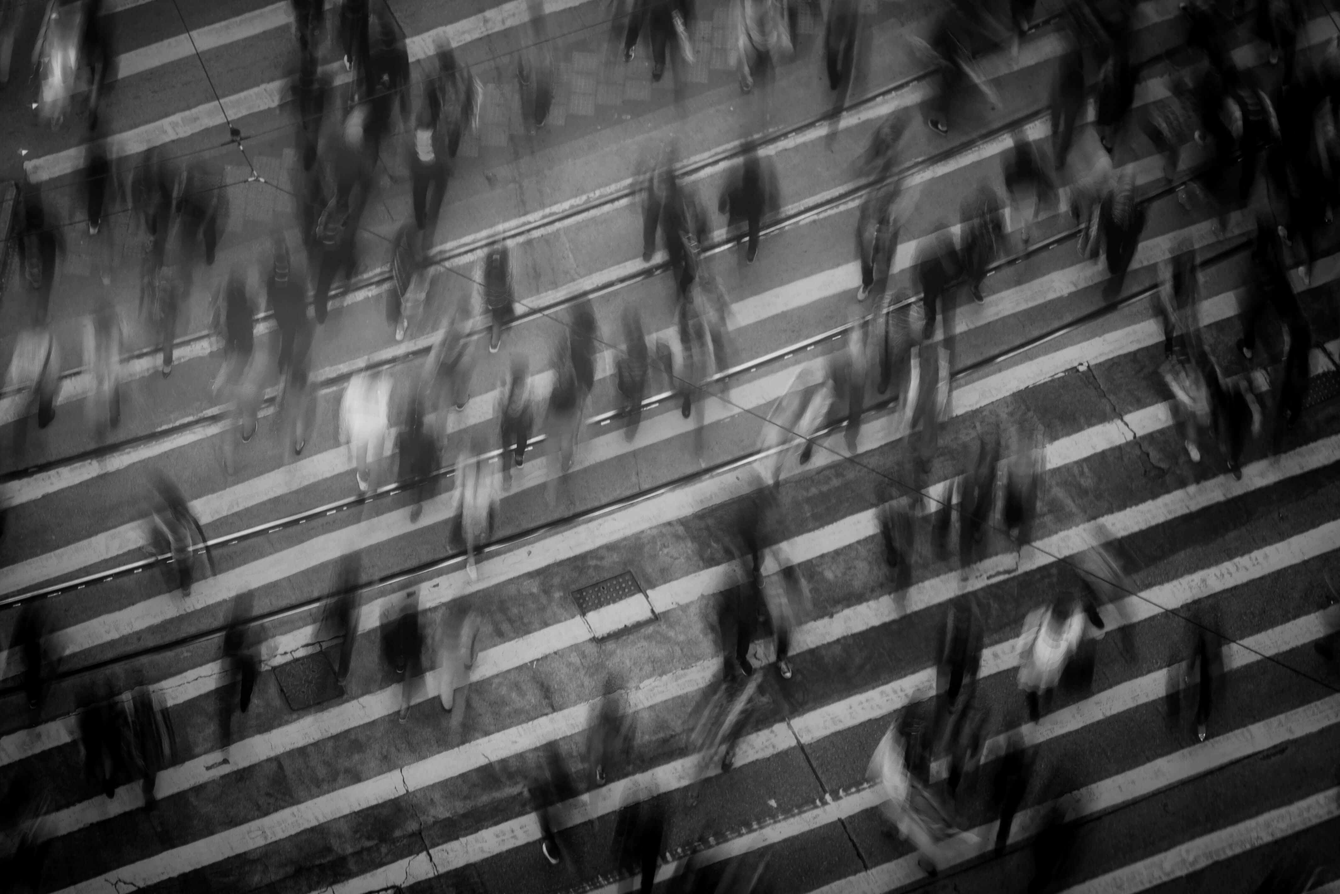motion blur of people walking on pedestrian lane