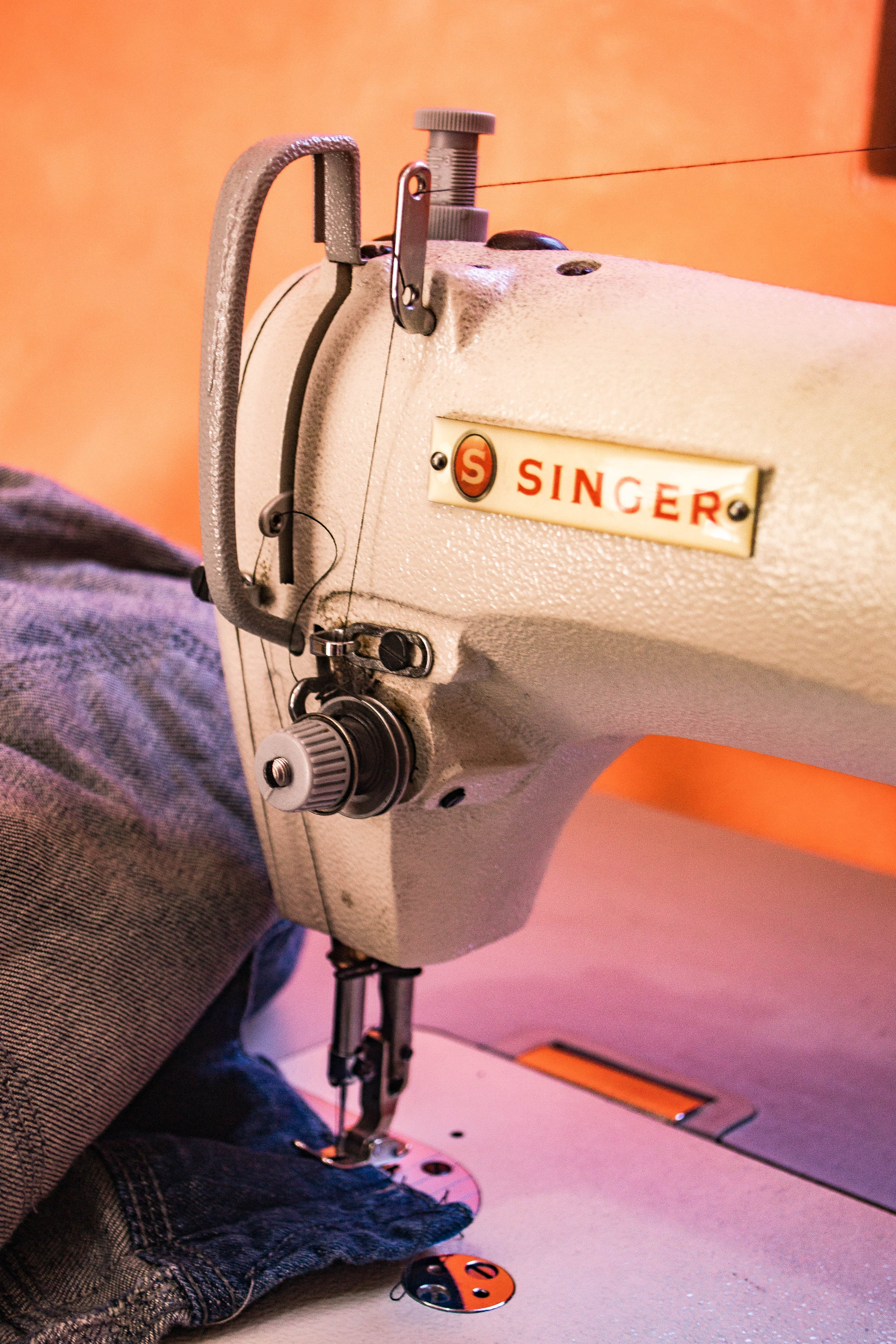 White Singer Sewing Machine on gradient background - make money iPhone photos