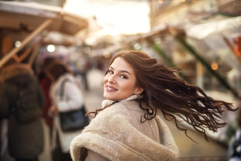 Caucasian girl doing a hair flip. - depth in iPhone