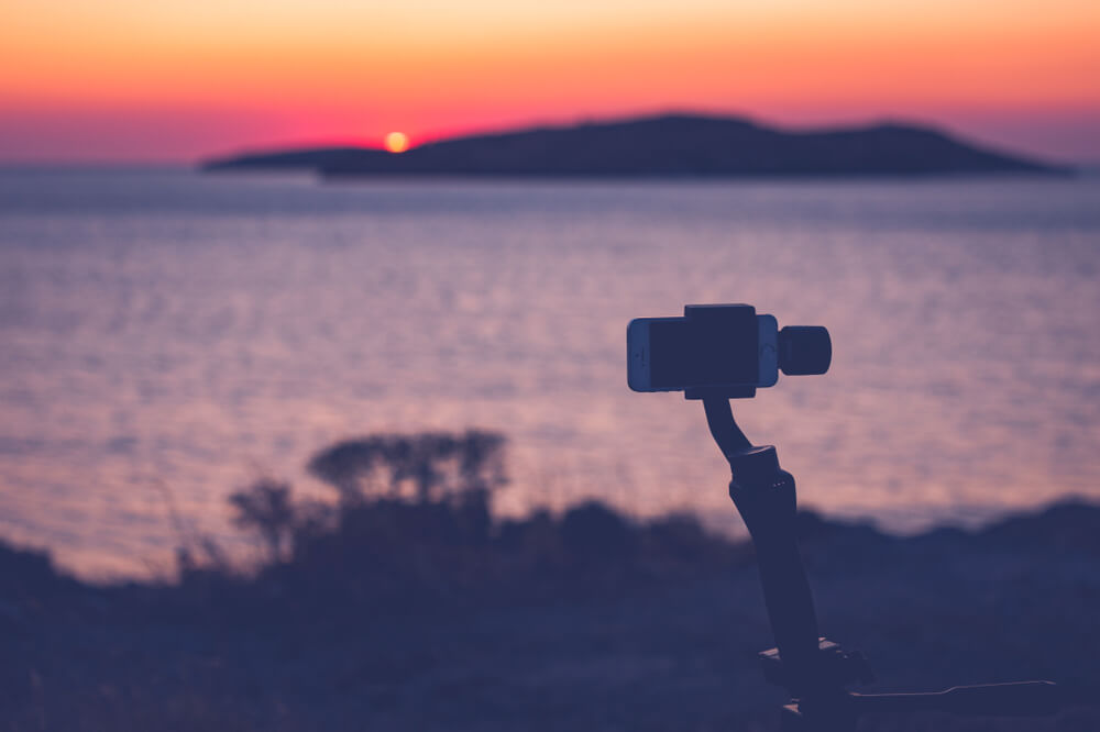 tripod with iPhone at sunset.