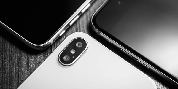 :New Iphone XS smartphone model in close up.Newest white Apple Iphone 11 mobile phone & other phones with touch screen.Top expensive wireless gadget to stay always connected