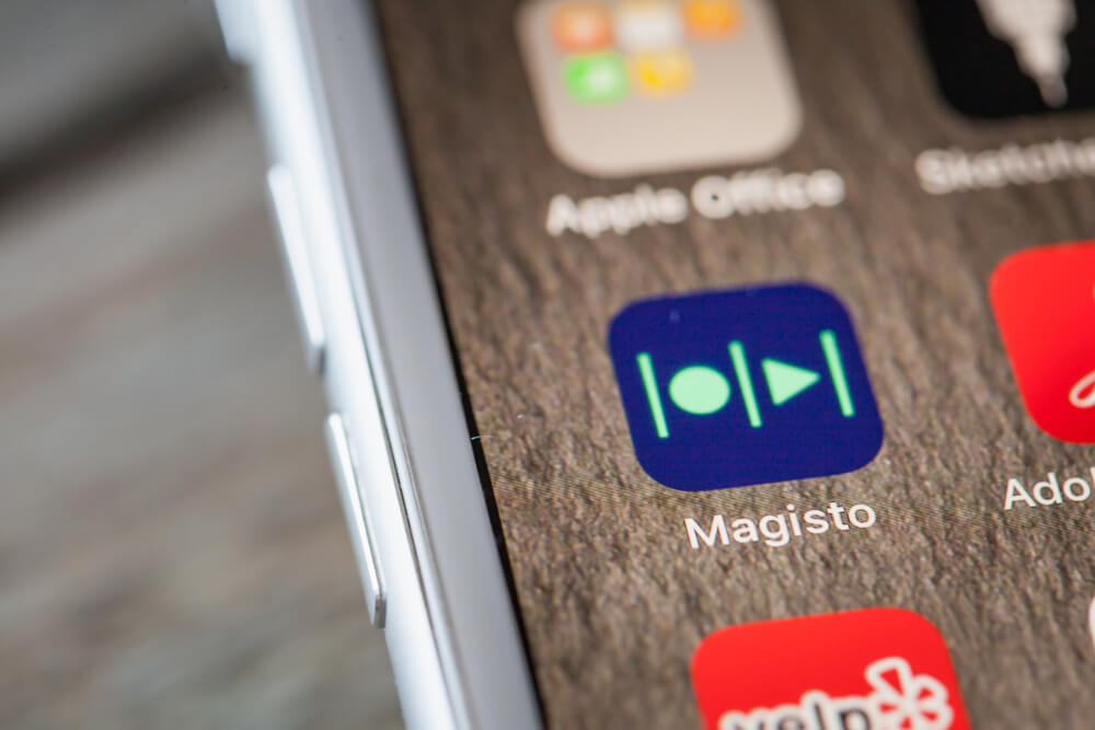 Magisto app logo on white iPhone