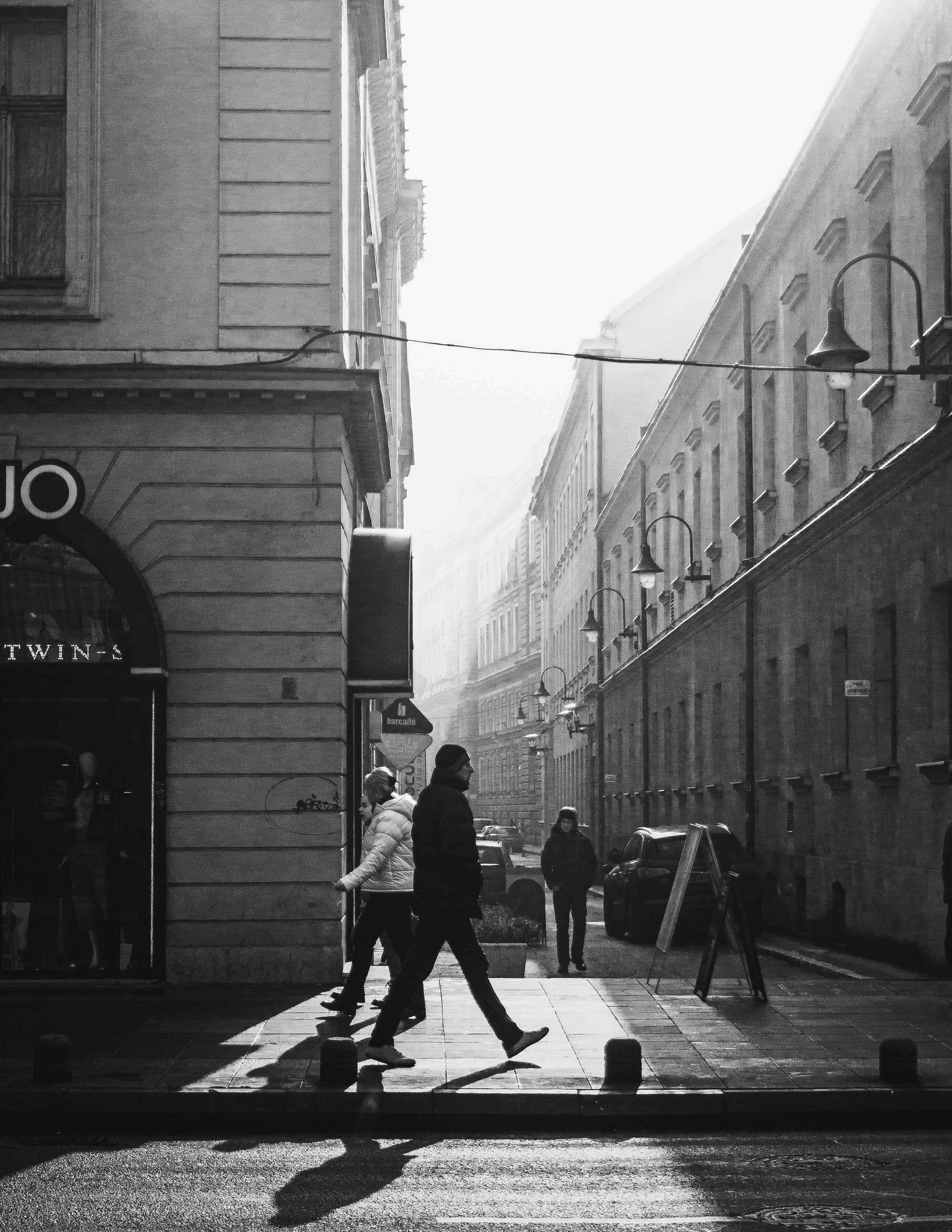Grayscale Photo of People Walking on Sidewalk - iPhone camera burst mode