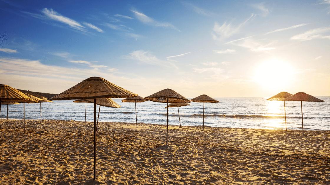 beach umbrellas at sunset - iPhone stock camera app
