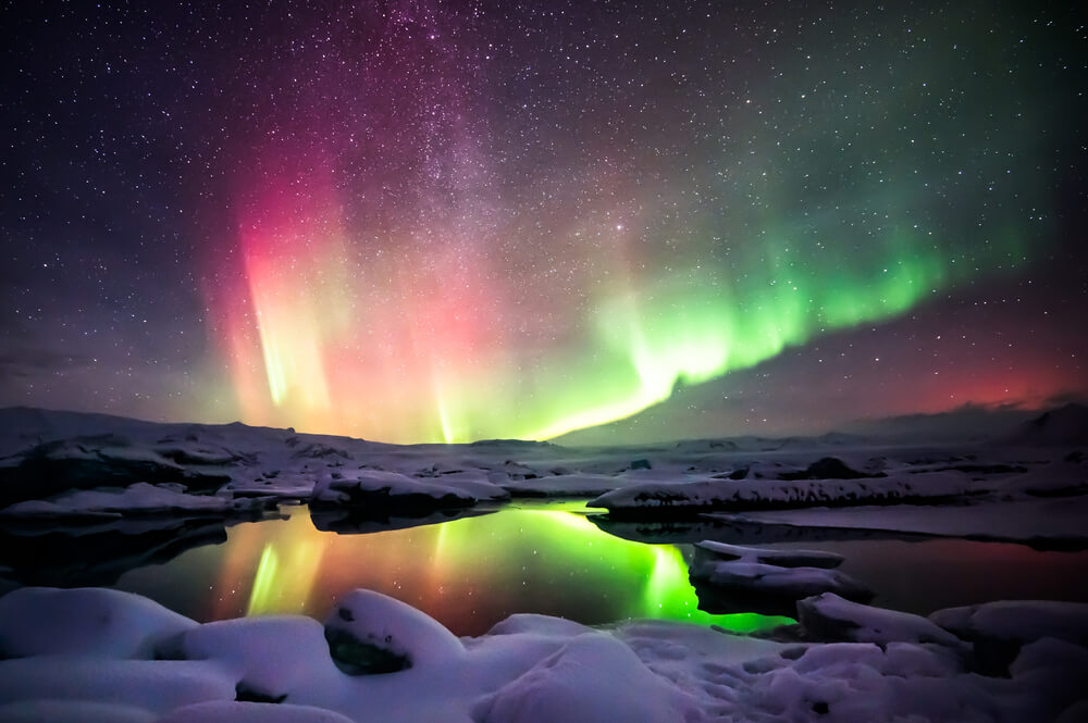 colorful Aurora Borealis with stars and snowy water landscape - Northern Lights on iPhone
