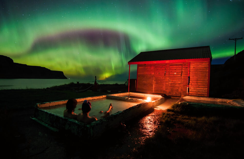 couple in hot tub - Northern Lights on iPhone