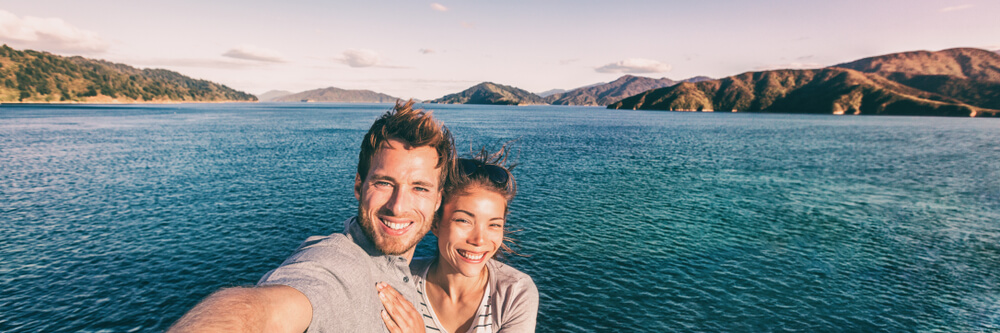 panorama photo of couple in the ocean