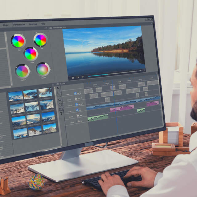 a video editor editing on a large monitor - best monitors for video editing