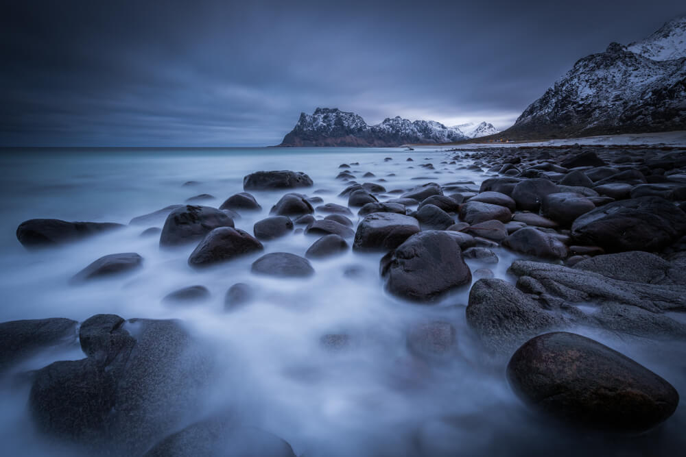 long exposure photo of rocky seashore in a gloomy day