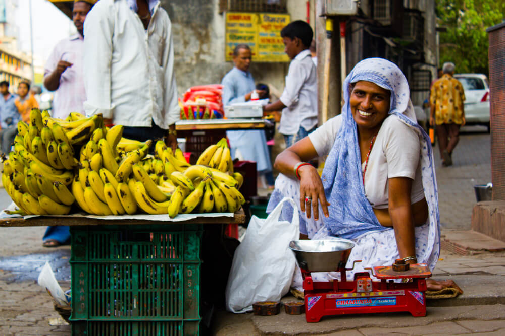 woman selling bananas in the street
