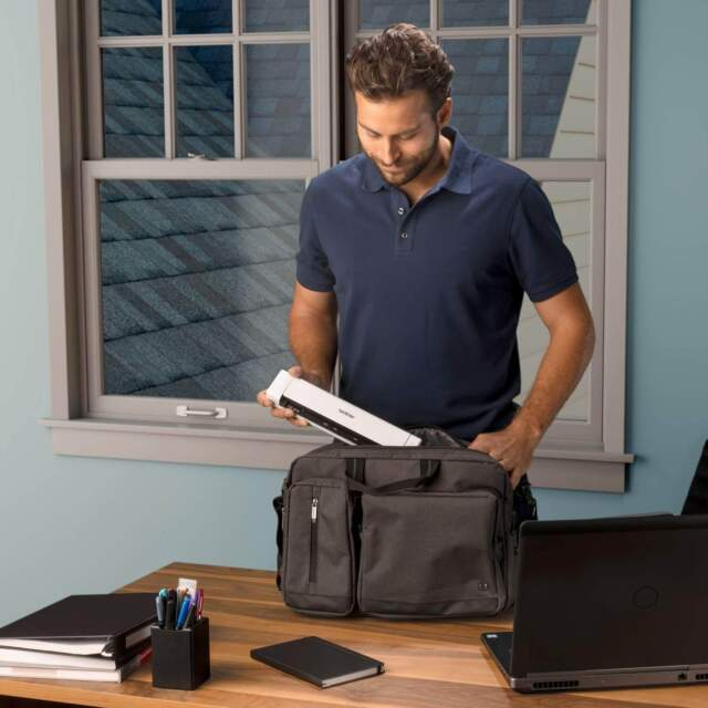 best wand scanners - a guy putting a scanner inside his bag